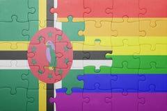 Déconcertez avec le drapeau national de la Dominique et du drapeau gai Image libre de droits