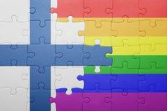 Déconcertez avec le drapeau national de la Finlande et du drapeau gai Photographie stock libre de droits