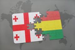 déconcertez avec le drapeau national de la Géorgie et de la Bolivie sur une carte du monde Image stock