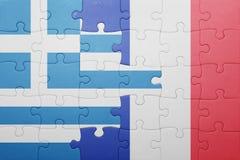 Déconcertez avec le drapeau national de la Grèce et des Frances Images stock