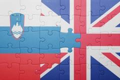Déconcertez avec le drapeau national de la Grande-Bretagne et de la Slovénie Photos stock
