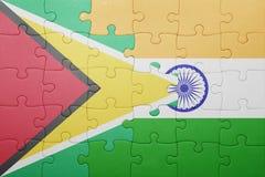 Déconcertez avec le drapeau national de la Guyane et de l'Inde Photographie stock