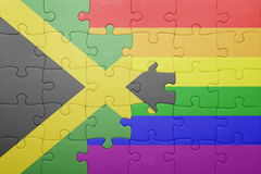 Déconcertez avec le drapeau national de la Jamaïque et du drapeau gai Image libre de droits
