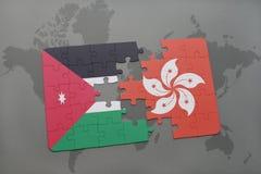 déconcertez avec le drapeau national de la Jordanie et de Hong Kong sur un fond de carte du monde Photographie stock libre de droits