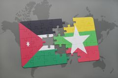 déconcertez avec le drapeau national de la Jordanie et de myanmar sur un fond de carte du monde Photos libres de droits