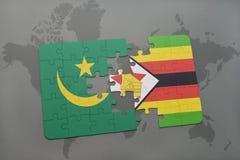 déconcertez avec le drapeau national de la Mauritanie et du Zimbabwe sur une carte du monde Photo stock