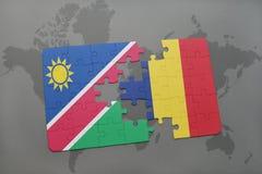 déconcertez avec le drapeau national de la Namibie et du confetti sur une carte du monde Photo libre de droits
