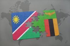 déconcertez avec le drapeau national de la Namibie et de la Zambie sur une carte du monde Photos stock