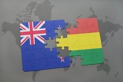 déconcertez avec le drapeau national de la Nouvelle Zélande et de la Bolivie sur un fond de carte du monde Photos stock