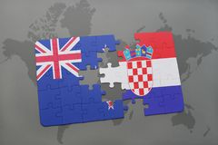 déconcertez avec le drapeau national de la Nouvelle Zélande et de la Croatie sur un fond de carte du monde Photographie stock libre de droits