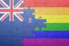 Déconcertez avec le drapeau national de la Nouvelle Zélande et du drapeau gai Photos stock