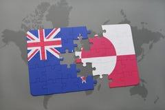 déconcertez avec le drapeau national de la Nouvelle Zélande et du Groenland sur un fond de carte du monde Photos stock
