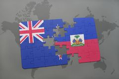 déconcertez avec le drapeau national de la Nouvelle Zélande et du Haïti sur un fond de carte du monde Photographie stock libre de droits