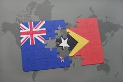 déconcertez avec le drapeau national de la Nouvelle Zélande et du Timor oriental sur un fond de carte du monde Image stock