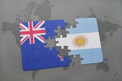 déconcertez avec le drapeau national de la Nouvelle Zélande et de l'Argentine sur un fond de carte du monde Photo stock