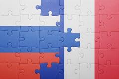 Déconcertez avec le drapeau national de la Russie et des Frances Photographie stock libre de droits