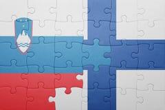 déconcertez avec le drapeau national de la Slovénie et de la Finlande Photo libre de droits