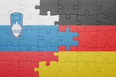 Déconcertez avec le drapeau national de la Slovénie et de l'Allemagne Images stock