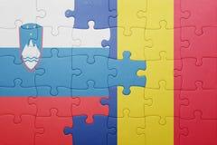 déconcertez avec le drapeau national de la Slovénie et de la Roumanie Photo libre de droits