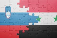 déconcertez avec le drapeau national de la Slovénie et de la Syrie Images libres de droits