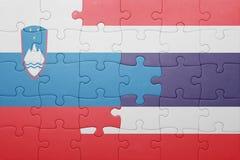 Déconcertez avec le drapeau national de la Slovénie et de la Thaïlande Image stock