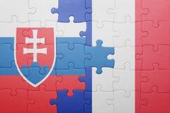 Déconcertez avec le drapeau national de la Slovaquie et des Frances Images stock