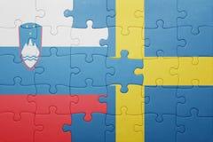 déconcertez avec le drapeau national de la Suède et de la Slovénie Images stock