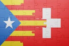 déconcertez avec le drapeau national de la Suisse et de la Catalogne Image libre de droits