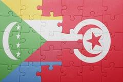 déconcertez avec le drapeau national de la Tunisie et des Comores Photographie stock libre de droits