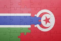 déconcertez avec le drapeau national de la Tunisie et de la Gambie Image libre de droits