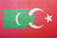 Déconcertez avec le drapeau national de la Turquie et des Maldives Images stock