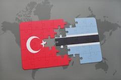 déconcertez avec le drapeau national de la Turquie et du Botswana sur une carte du monde Photo libre de droits