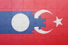 Déconcertez avec le drapeau national de la Turquie et du Laos Image libre de droits