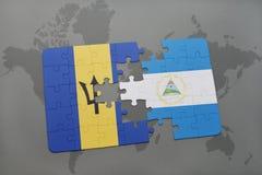 déconcertez avec le drapeau national des Barbade et du Nicaragua sur un fond de carte du monde Photo stock