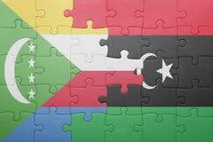 déconcertez avec le drapeau national des Comores et de la Libye Image libre de droits