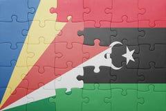 déconcertez avec le drapeau national des Seychelles et de la Libye Image stock