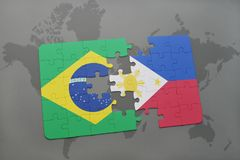 déconcertez avec le drapeau national du Brésil et des Philippines sur un fond de carte du monde Photographie stock libre de droits