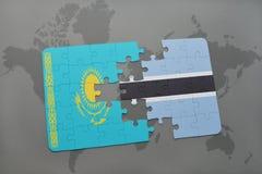 déconcertez avec le drapeau national du Kazakhstan et du Botswana sur une carte du monde Photographie stock