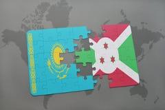 déconcertez avec le drapeau national du Kazakhstan et du Burundi sur une carte du monde Images stock