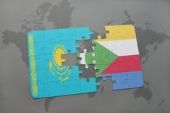déconcertez avec le drapeau national du Kazakhstan et des Comores sur une carte du monde Photo libre de droits