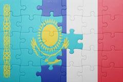 Déconcertez avec le drapeau national du Kazakhstan et des Frances Images stock