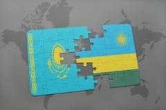 déconcertez avec le drapeau national du Kazakhstan et du Rwanda sur une carte du monde Photographie stock