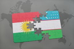 déconcertez avec le drapeau national du Kurdistan et de l'Ouzbékistan sur un fond de carte du monde Photographie stock libre de droits