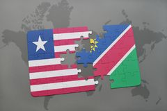 déconcertez avec le drapeau national du Libéria et de la Namibie sur une carte du monde Image libre de droits