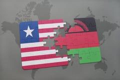déconcertez avec le drapeau national du Libéria et du Malawi sur une carte du monde Images stock