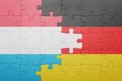 Déconcertez avec le drapeau national du Luxembourg et de l'Allemagne Photographie stock