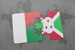 déconcertez avec le drapeau national du Madagascar et du Burundi sur une carte du monde Photographie stock