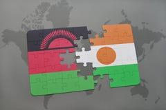 déconcertez avec le drapeau national du Malawi et du Niger sur une carte du monde Photo libre de droits