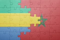 déconcertez avec le drapeau national du Maroc et du Gabon Image libre de droits