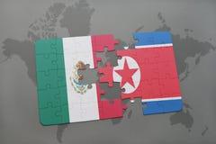 déconcertez avec le drapeau national du Mexique et de la Corée du Nord sur un fond de carte du monde Images libres de droits